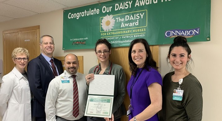 Melanie Cadin, RN, DAISY recipient with Crouse leadership
